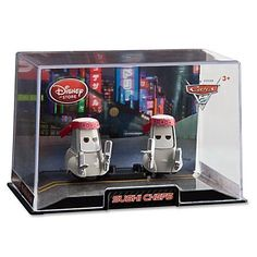Disney Cars 2 Sushi Chefs Cars 2 Die Cast Car Set -- 2-Pc. 1/48 by Disney. $4.90. Comes in plastic case with scenic display backing. Finely detailed die cast metal. Each Suchi Chef is 1 3/4'' H x 1 1/8'' W x 2 1/4'' L. Set includes two Sushi Chef vehicles. Relive the raw excitement of Cars 2 with the Sushi Chefs Cars 2 Die Cast Car Set. The pair of forklift fish filleters look deliciously cute with their bandanas and will make fans of the movie hungry to add th...