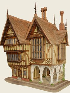 I have never wanted a dollhouse so badly in my life. I love the Tudor designs by Triggerpond!
