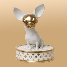 Uta Koloczek is a ceramicist based out of Berlin whose re-interpretation of the classic porcelain figurine has me smiling from ear to ear. I love her playful, modern approach and, of course, her subject matter: dogs!