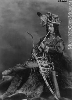 "Seen in the composite with bow and arrow, Mr. Reynolds as ""Quewaygoosquequamteros"" is typical of the way Victorians portrayed romanticized exotic characters from other cultures. Many of the people who donned exotic fancy dress acted out stereotypes-men dressed in Aboriginal costume waved tomahawks and gave war whoops, reinforcing the period's widely accepted stereotype of the savage warrior.    Mr. Reynolds's costume is composed of authentic Aboriginal-made elements, all available at this…"