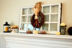 use an old window like this, make a cute wreath for it to hang over for the fireplace mantle