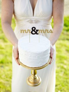 Mr. and Mrs. gold wedding cake topper