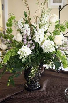 Buffet Piece composed of bells of ireland, white stock, lavender delphinium, white roses and mix of greenery by kcampany