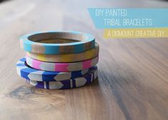 Painted Tribal Bracelets.  How I love these. You don't have to pain over them you could also wrap chains, gimp, or string over it or even poke holes through a thinner one & sew any material or chains through it as well. Pretty darn neat if I do say so myself. ;)