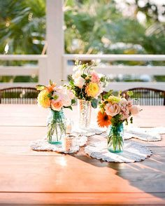 These simple centerpieces are easy to create on your own making each flower arrangement a great option for a low-key wedding reception, bridal shower, or spring celebration.