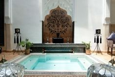 Roof terrace fireplace, Marrakech Riad with pool