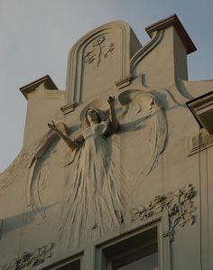 Beautiful facade in Pilsen, Czech Republic.  A welcoming, expansive gesture.