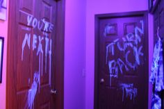 """An Idea for your next Halloween Party. This year I decided to try something new.  I put a black light in the hallway, and painted """"you're next"""" on the bathroom door (pun intended), and """"turn back"""" on the bedroom door.  I used laundry soap (Tide free) as the paint and used a washcloth as the """"brush.""""  The result? When it's light you can not see any writing, but when it is dark and the hallway black light is turned on...spooky, glowing ghostly warnings!  Everybody loved this."""