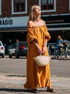 The Perfect Yellow Dress To Welcome Summer - Jeanette Friis Madsen wearing a yellow maxi dress, a straw bag and black slide sandals. Dress Outfits, Casual Dresses, Summer Dresses, Maxi Dresses, Beach Outfits, Travel Outfits, Outfit Summer, Vacation Outfits, Casual Outfits