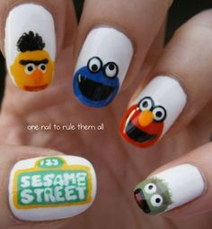 Sesame Street nails (again), I wish my phone/tumblr would stop deleting things, anyway, these were requested by my friend Blythe, I had to change the sign to make it fit my nail but I hope you like them anyway :)