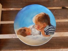 This is a limited edition Pemberton & Oakes collector plate entitled Brotherly Love. It is by the artist Donald Zolan and is the first issue in