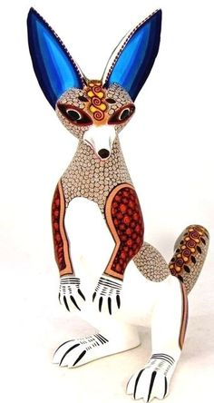 This wonderful fox was hand carved and expertly painted by Eduardo Fabian of Oaxaca, Mexico.