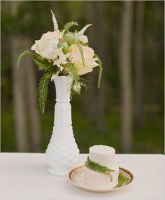 milk-glass flower arrangements and mini cake