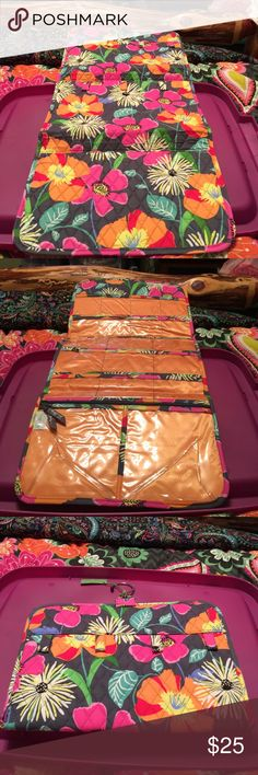 Vera Bradley keep it up organizer Jazzy blooms. Back has 7 snap necklace holders. Inside has 17 slip pockets and 2 zip pockets. Has a hanger as well. Vera Bradley Accessories