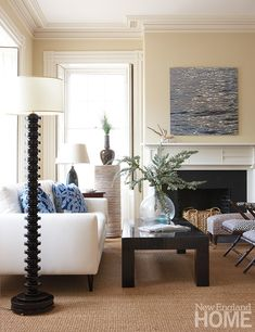 Barnes gave the living room a neutral backdrop and added pops of blue, including an arresting water photograph by Tamara Bahry Paterson.