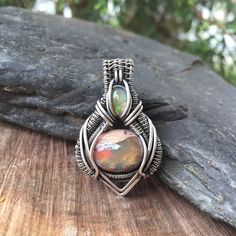 A personal favorite from my Etsy shop https://www.etsy.com/listing/292303805/wire-wrapped-pendant-heady-wire-wrap