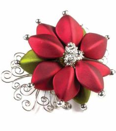 Accessories for a holiday party with this pretty poinsettia pin! #fabulouslyfestive