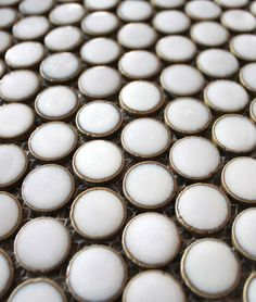 metal rim penny tiles--oh my wow...need this somewhere