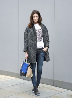 shirt and belt by Acne, jeans J Brand, coat Isabel Marant, shoes Nowhere, bag Celine and watch Tagheuer. (