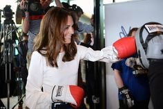 The Duchess of Cambridge showed she can pack a real punch today as she donned a pair of red boxing gloves for an impromptu sparring match at London's Queen Elizabeth Olympic park