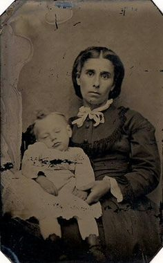 Mother with deceased child. The grief in her face is so sad Photos were very expensive so the family and friends would pool their money so they would have the photo to remember the child. these type of photos were called Memento Mori.