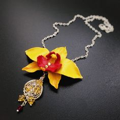 Yellow Orchid, Orchid Necklace, Yellow Orchid Pendant, Polymer Clay Flower Necklace, Pendant With Flower, Swarovski, Gift Idea by NadiaLaukkanen on Etsy https://www.etsy.com/listing/520509353/yellow-orchid-orchid-necklace-yellow