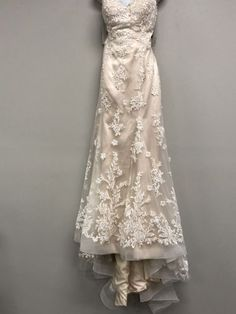 Maggie Sottero wedding dress currently for sale at 82% off retail.