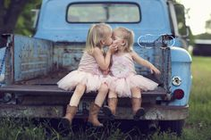 adorable sister poses for little lassies :)... I REALLY want a old truck for pics!