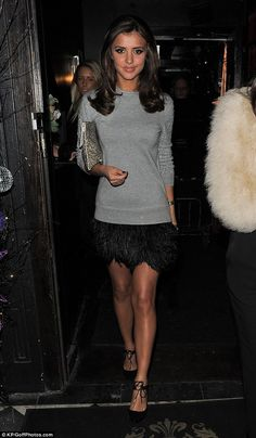 Gorgeous in grey: Former TOWIE star Lucy Mecklenburgh was also spotted at the launch as she showed off her lean legs in a feathered black skirt