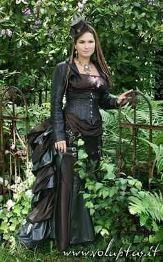 Stempunk bustle dress in brown and black with underbust corset, buckles, and bolero jacket.