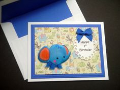 This little card especially for someone's first birthday features a puffy blue baby elephant and an embossed oval with Happy Birthday 1st Birthday Cards, Baby 1st Birthday, Happy 1st Birthdays, Blue Bow, Safari Animals, Baby Elephant, White Envelopes, Baby Blue, Card Stock