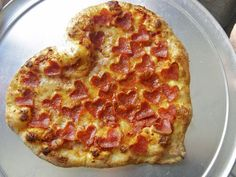 Heart shaped salami pizza