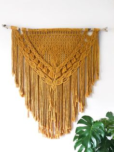 Over 1400 ft. of Magnificent Mustard luxe rope in this macrame wall hanging. By The Bohemery Co.   Thebohemeryco.com