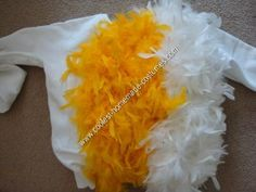 Pin Feather Boas to Sweatshirt: My daughter wanted to be a chicken for Halloween this year. Considering I do not sew, I put the entire homemade chicken Halloween costume together with