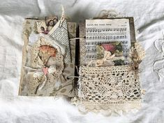 Love....... This heirloom journal is a one of a kind beauty handmade by me filled with Beautiful papers, vintage laces, fabrics and so much more. Handmade cover layered with corrugated card, fabric, lace, vintage book pages, vintage buttons, vintage millinery, large vintage inspired