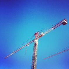 Tower Crane against a crystal blue sky