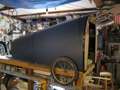 The shell was made by arcing sheets of fluted plastic. The nose is tapered down for better aerodynamics when traveling.