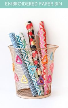 """Embroider"" your wastebasket with pipe cleaners. 