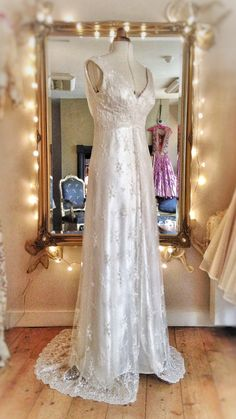 Pale ivory beaded lace and silk satin empire line wedding dress by Joanne Fleming Design