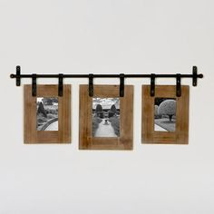 One of my favorite discoveries at WorldMarket.com: Jacob 3-Photo Wall Frame-- Use IKEA bar and hooks to hang frames?