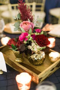 This gorgeous centerpiece by Kate Foley Designs highlights the navy, berry and gold tones selected by MaryEllen and Lou! Amanda Jameson captured this modern and elegant wedding. Wedding Planner: Grit and Gold   Decor/Rentals: Posh Couture Rentals   Florist: Kate Foley Designs#bridesofnorthtx #centerpiece