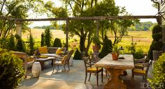 The Indonesian Antique daybeds, Arm chairs & Plantation Chair are right at home on this terrace. Michael Trapp home.