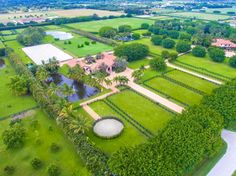 This stunning rarely offered 33.5 acre equestrian compound in the heart of Wellington is located within minutes of the Winter Equestrian Festival, Global Dressage Festival, and International Polo Club. The compound has a total of 32 stalls divided between two barns; the Grand Prix Barn and the Ranch Barn. The Grand Prix Barn features: 18 Lucas Equine stalls customized on site with EBY wood and handmade patented brass horse water faucets, vaulted cypress ceilings with cupolas for extra…