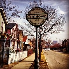 Corktown, located directly south of Michigan Avenue, and directly west of the Lodge Freeway. Corktown is the oldest neighborhood in Detroit. This neighborhood, listed on the National Register of Historic Places, is called Corktown because most of its first residents were from County Cork, in Ireland. Corktown is home to some Detroit landmarks, such as the Michigan Central Station and Tiger Stadium, which no longer stands.