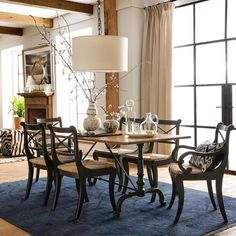"""We're setting the table for dinner and loving a.) the """"extra"""" hour of daylight and b.) the lines and curves on the La Coupole Iron Bistro Table and Madeline Dining Chairs!  Shop them via the link in our profile. #mywilliamssonoma"""