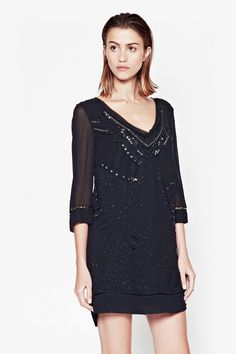 """<ul> <li> Beaded and embroidered tunic dress with decorative cut-outs</li> <li> 3/4 length sleeves with cut-out detail and beads at cuffs</li> <li> Heavily beaded V-neckline</li> <li> Inner lining</li> <li> Plunging scoop back detail with beads and semi-sheer mesh panel</li> <li> UK size 10 length is 82.3cm</li> </ul>  <strong>Our model is 5ft 10.5"""" and is wearing a UK size 10.</strong>"""