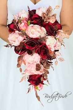 Rose gold and blush wedding brides bouquet cascading