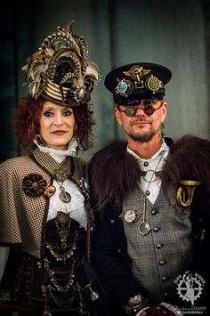 Luxe Steampunk Couple (man and woman whose clothing use beautiful fabrics, and accessorize well) - For costume tutorials, clothing guide, fashion inspiration photo gallery, calendar of Steampunk events, & more, visit SteampunkFashionGuide.com