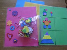 Laminate colored sheets of paper with grids; make patterns on one side using foam craft pieces with sticky backs; kids can copy patterns on opposite side.