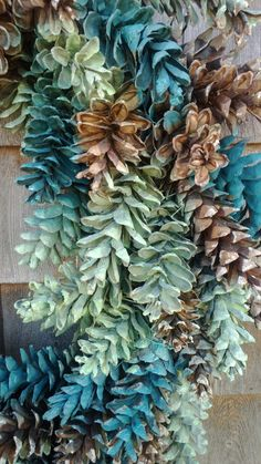 Loving the paint this year on pinecones. Lets do this with the giant sugar pine pinecones from PineconeJunkie.com! Pinecone Wreath 89 dollarsat Etsy